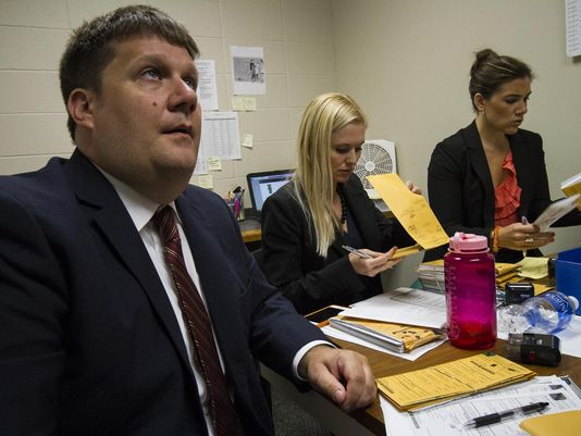 Assistant Commonwealth Attorneys John Balenovich, left, and Diane Arnold, center, review cases for the new rocket docket while working alongside Felony Pilot Project Prosecutor Jessica Moore in their shared offices. (Photo: Matt Herp, Special to the C-J)