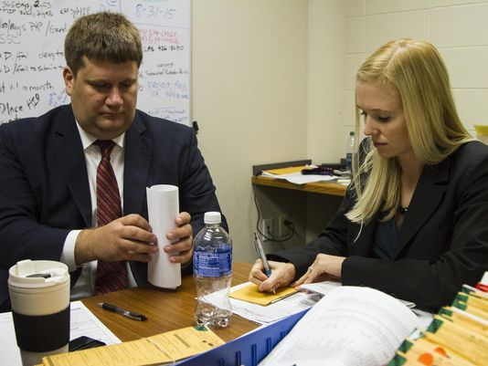 Assistant Commonwealth Attorneys John Balenovich and Diane Arnold review cases to see if they are eligible for the new rocket docket. (Photo: Matt Herp, Special to the C-J)